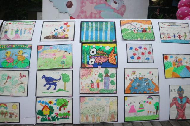 七彩童年,快乐绽放 ——记仪幼北城分园幼儿美术作品展评活动